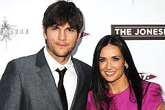 Amid rumors of marital strife, Ashton Kutcher and Demi Moore pose before jetting off to Israel.