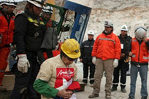 Chilean miner Mario Gomez dropped to his knees in prayer after being rescued.