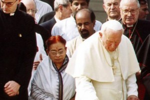 Pope John Paul II places a wreath on Mahatma Gandhi's tomb in November 1999.