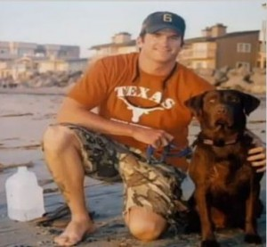 Navy Seal Officer Jon Tumilson with his black lab Hawkeye