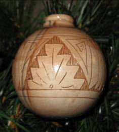 A striking Native American Christmas tree ornament