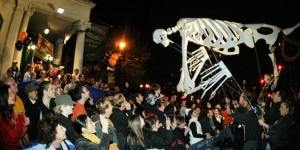 A giant skeleton goes crowd surfing