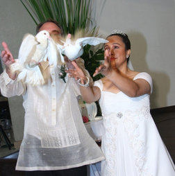 A traditional Catholic wedding in the Phillippines ushered in peace for James & Vina.