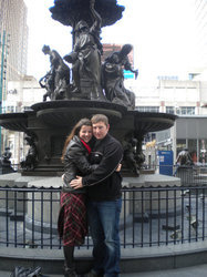 In front of Cincinnati's Fountain Square on the weekend Luke proposed.