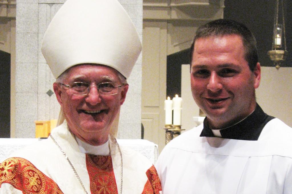 Bishop Martin John Amos of Davenport with seminarian Jake Greiner