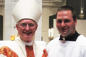 Bishop Martin John Amos of Davenport with seminarian Jake Greiner
