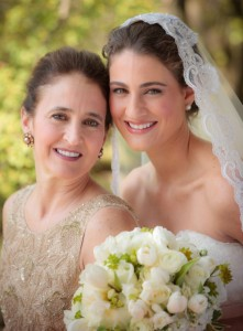 Regina with her mom on her wedding day