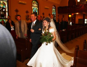 walking down the aisle at Maria's New Year's day wedding