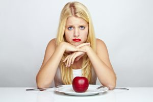 woman sad apple skinny weight