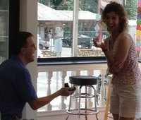 John brought Meredith back to the ice cream shop of their first date and stunned her with a ring.
