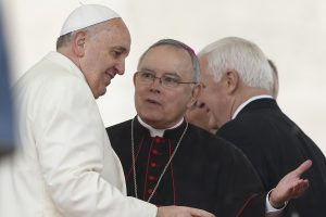 Pope Francis talks with Archbishop Chaput during general audience in St. Peter's Square at Vatican