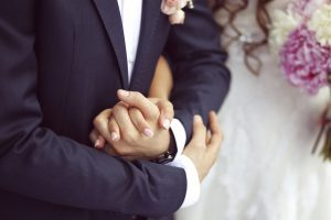 groom hands