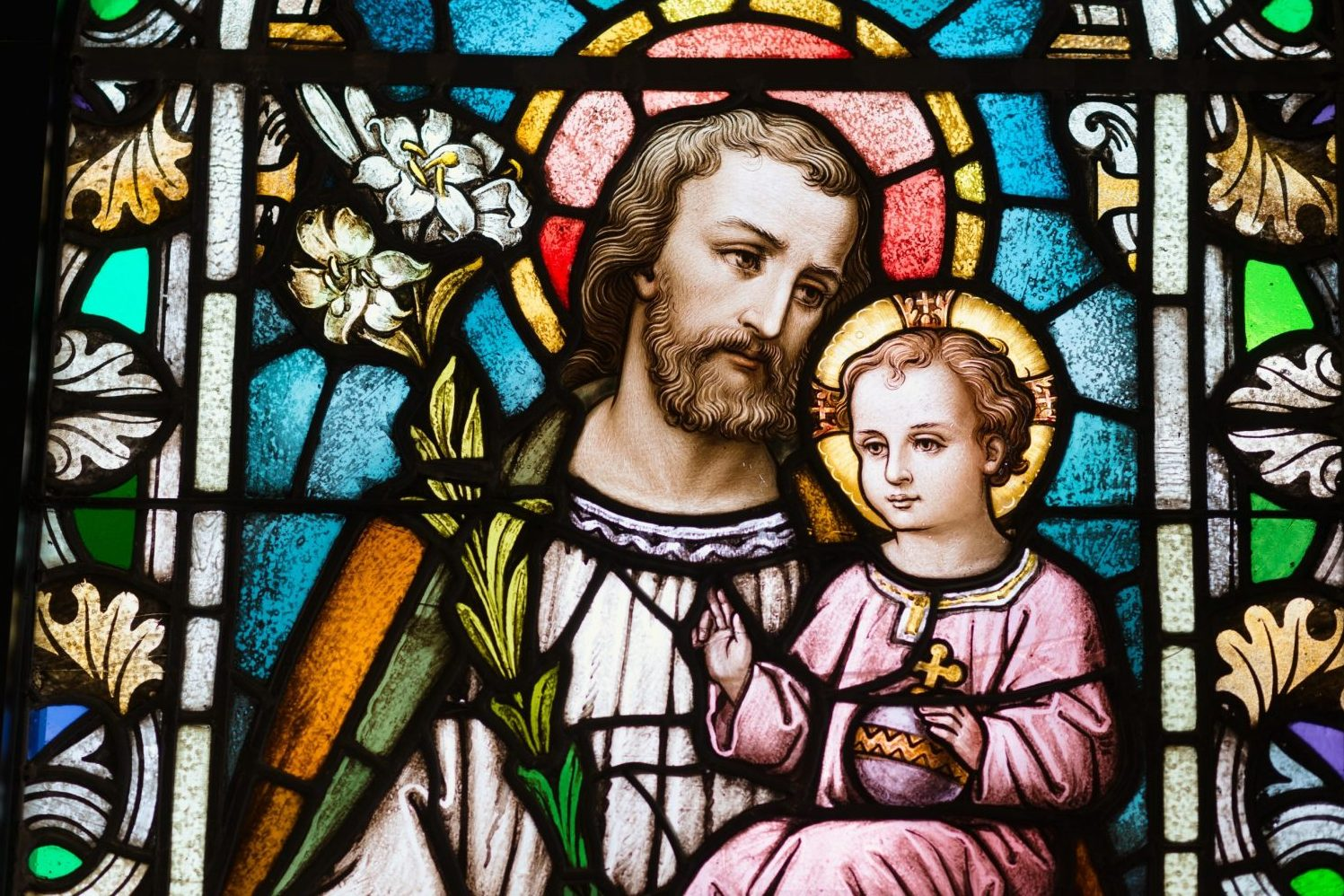 stained glass window of St. Joseph and Jesus